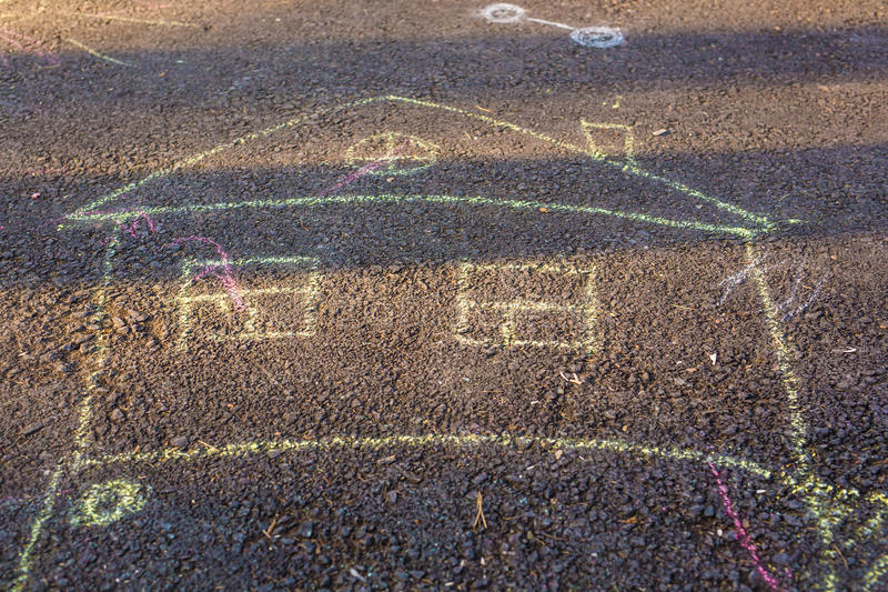 Children`s drawings of crayons on the pavement stock images