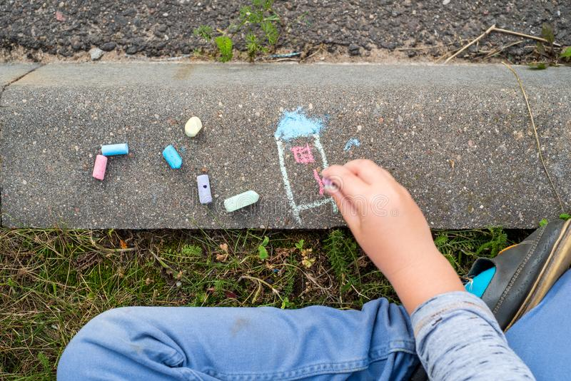 children's drawings with crayons on the pavement royalty free stock images