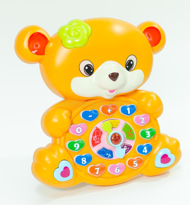 Children`s educational animal toy for learning numbers. Toy interactive bear with colorful buttons for presses Preschool stock photo