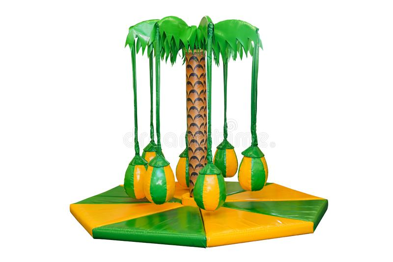 Children`s entertainment playground, recreation park. Place for children`s games. Kids carousels, swings, in form palm tree, und royalty free stock photos