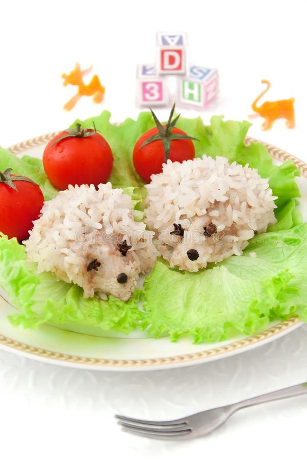 Children's food - two rice hedgehogs stock image