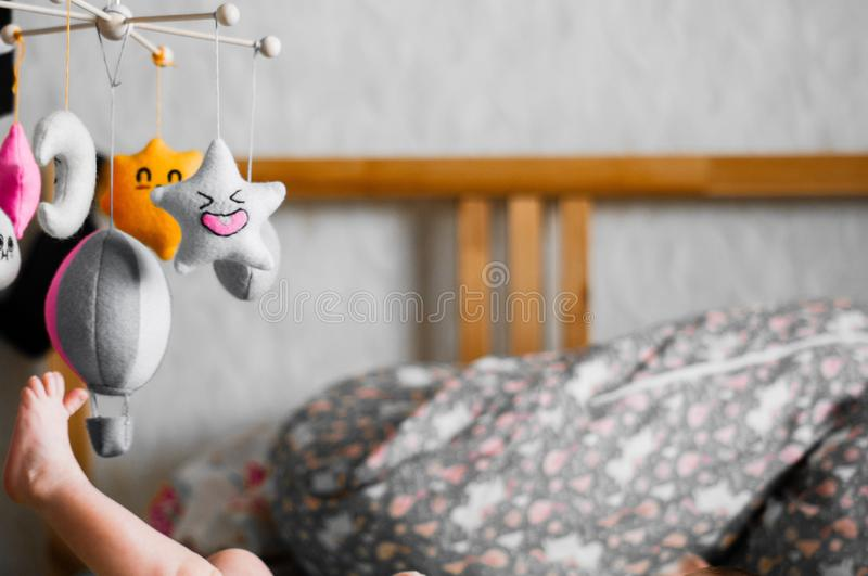 Children`s foot catches toy stock images