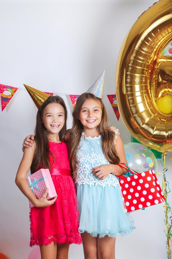 Children`s funny birthday party in decorated room royalty free stock image