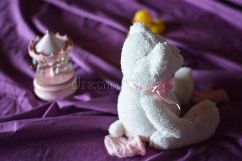 A teddy bear and a music box for children. Children`s games for a father`s party stock image