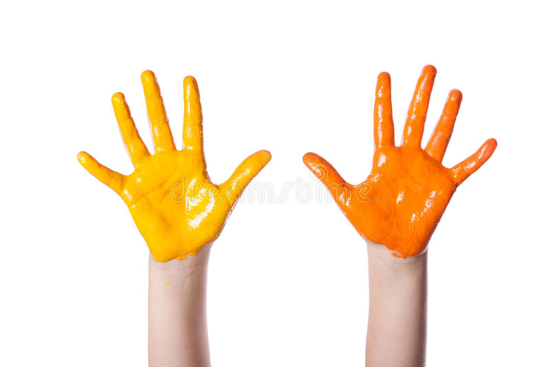 Children's hands colored dye. Isolated on white background stock photo