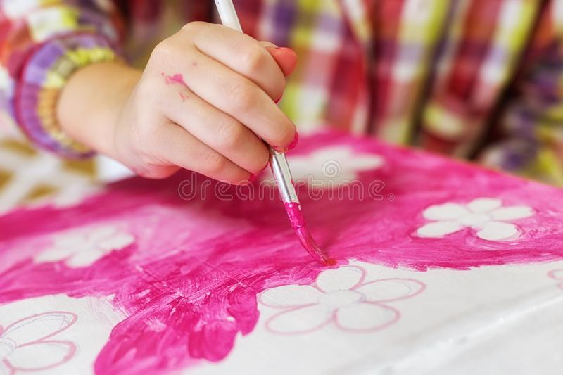 Children`s hands draw a house for dolls. child creativity Place for text royalty free stock photos