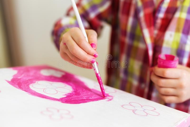 Children`s hands draw a house for dolls. child creativity Place for text royalty free stock photography