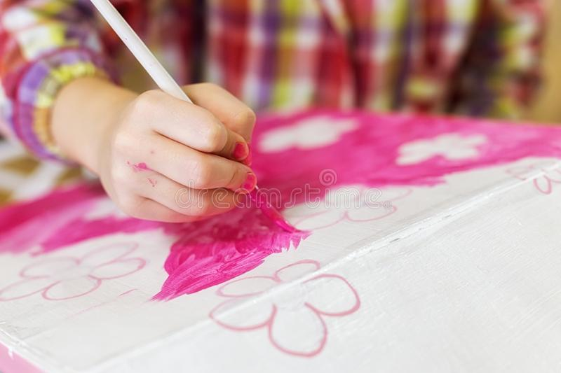 Children`s hands draw a house for dolls. child creativity Place for text stock photos