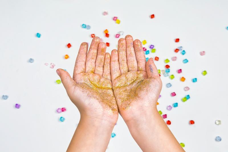 Children`s hands, hands holding beads on a white background stock photo