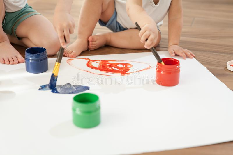 Children`s hands and paint brushes. stock images