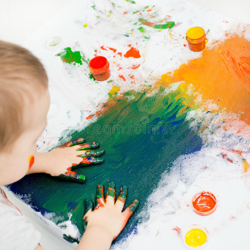 Children's hands in paint royalty free stock photo