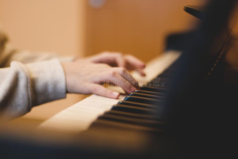 Children`s hands on the piano keys, rehearsal music, learning to play the piano.  royalty free stock photos