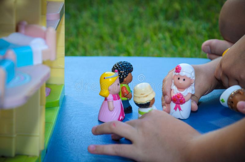 Children`s hands play toys dolls stock images