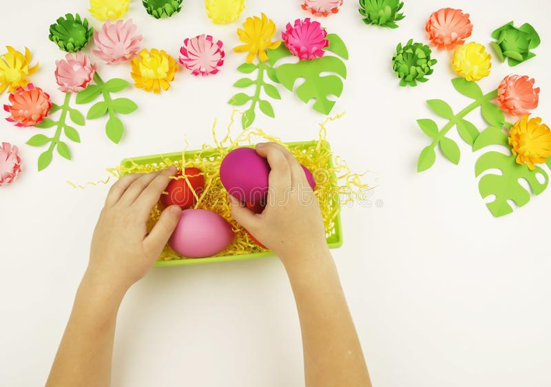 Childrens hands put easter eggs in a green basket easter download childrens hands put easter eggs in a green basket easter preparation mightylinksfo