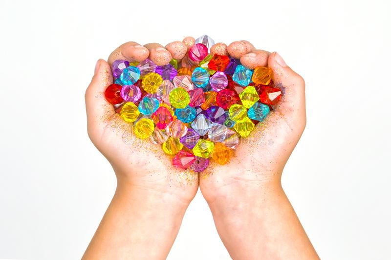 Children`s hands, hands holding beads on a white background royalty free stock photos