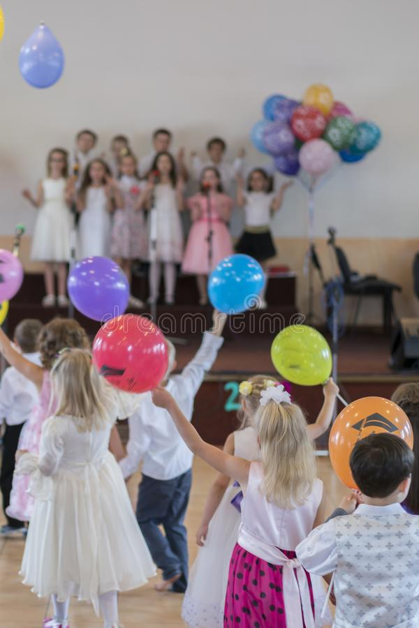 Children's holiday in kindergarten. Children on stage perform in front of parents. image of blur kid's show on stage at school. For background usage. Blurry royalty free stock photos
