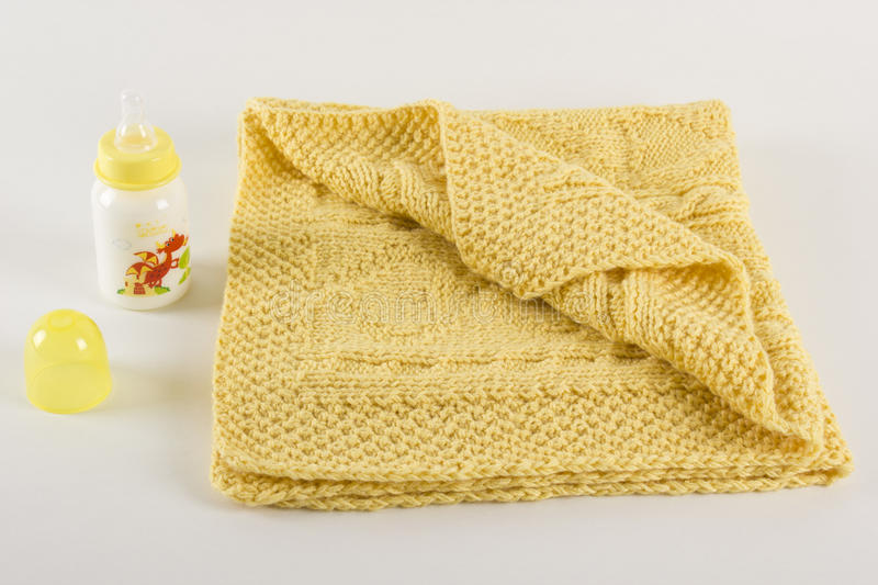 Children`s knitted plaid. Knitting on knitting needles with woolen thread, Autumn Plaid for the baby, Knitting on knitting needles, Warm woolen plaid for small royalty free stock image