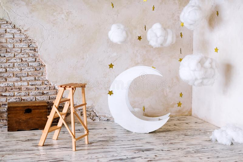 Children`s location for a photo shoot. Moon with stars and clouds dreamy decor. Elements of the interior. royalty free stock photos