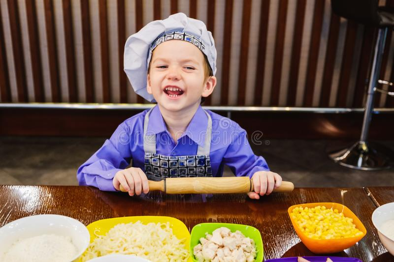 Children`s master class in cooking pizza royalty free stock photo