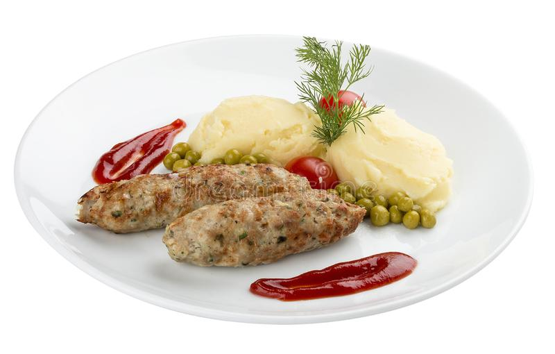 Children`s menu. Veal chops with mashed potatoes. On white background stock images