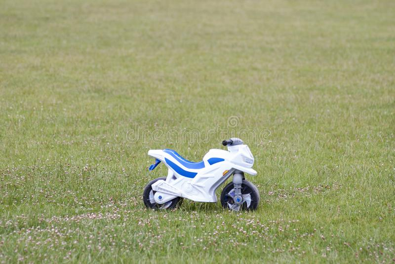 Children`s motorcycle on the field stock photography