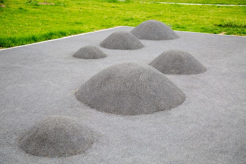 Children`s mounds covered with rubberized coating for sports grounds. Sports Recreation stock images