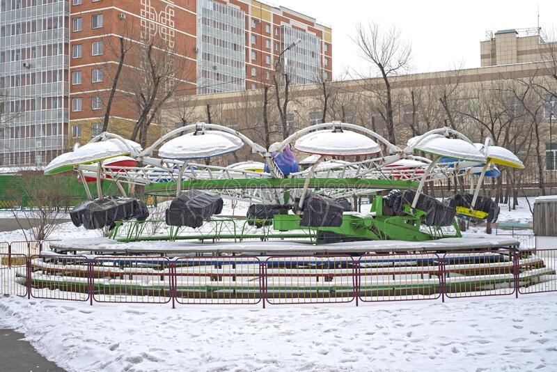 Children`s park with carousels, closed for the winter. Overcast weather royalty free stock photos