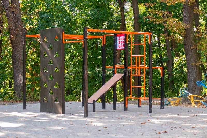 Children`s sports complex. Children`s playground with children`s sports complex in municipal park stock photography
