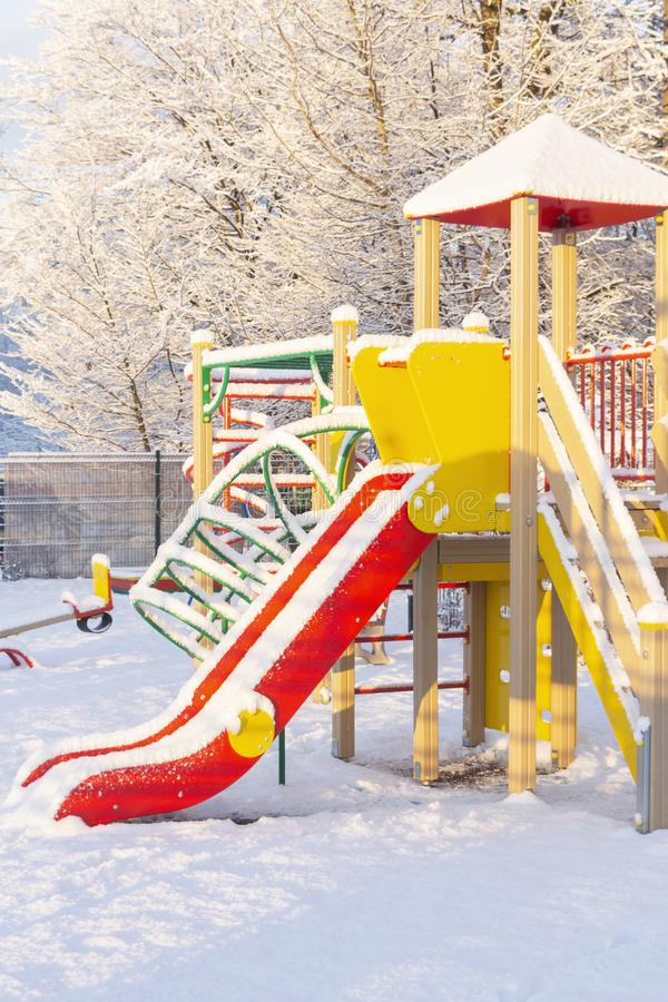 Children`s playground covered with snow.The concept of winter and harsh weather royalty free stock photos
