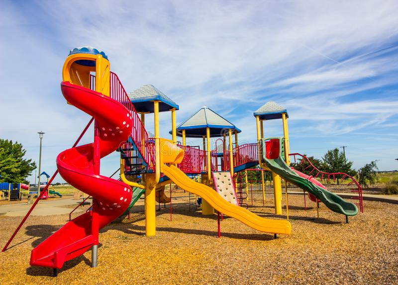 Children`s Play Ground Equipment In Early Morning. Children`s Play Ground Equipment With Multiple Slides In Early Morning stock photos