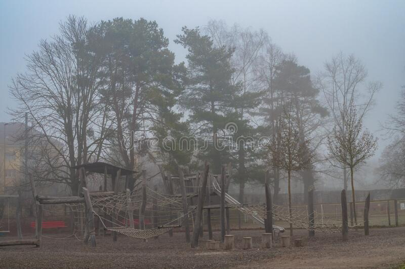 Children& x27;s playground in foggy day stock photography