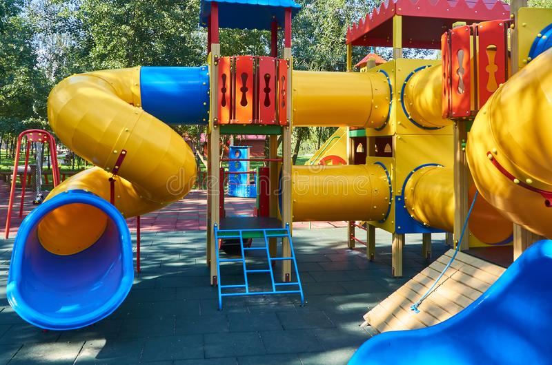 Children's playground in a public park, kid's entertainment and recreation royalty free stock photos