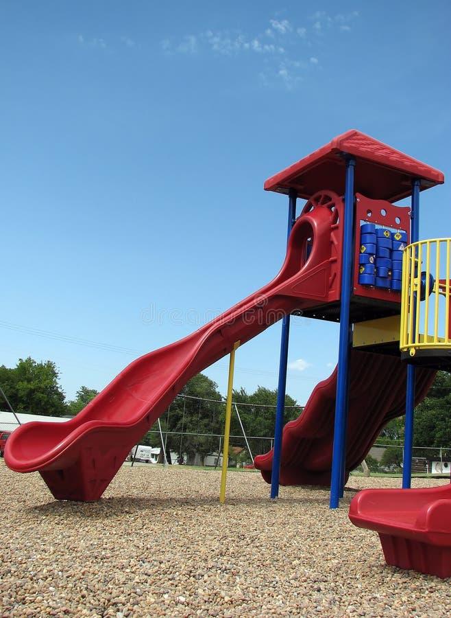 Children's Playground Slide. Big, red and blue children's slide found at an outdoor children's playground stock photo