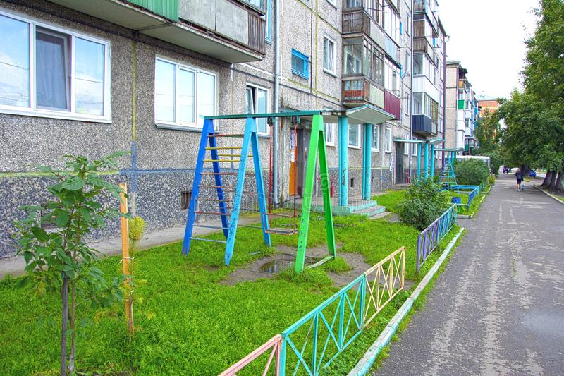 Children`s playground in a very small courtyard of an apartment building. Russia. royalty free stock images