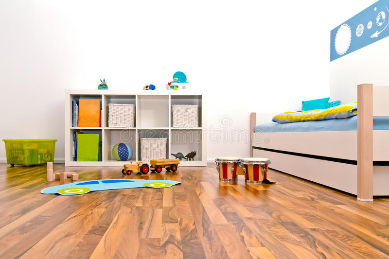 Children's Playroom. With bed and rack and some toys royalty free stock photography