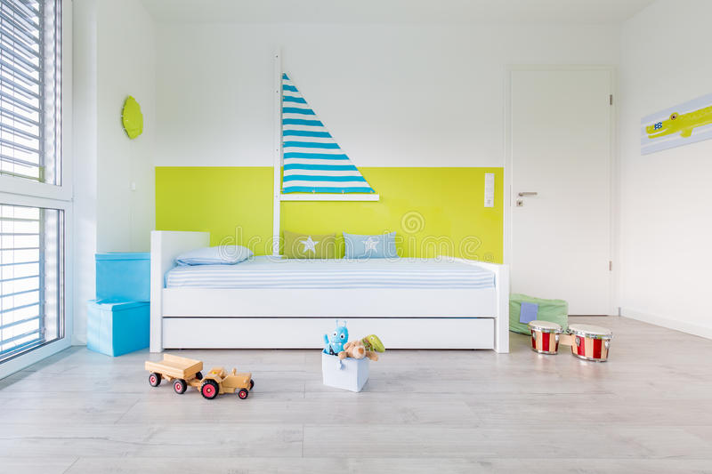 Children's playroom with bed. View in Children's playroom with a bed an large window stock photos