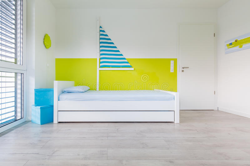 Children's playroom with bed. View in Children's playroom with a bed an large window royalty free stock photo