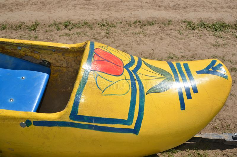 A yellow wooden shoe on tulip farm. This is a children`s ride in the form of a yellow wooden shoe on the Wooden Shoe Tulip Farm near Woodburn, Oregon stock images