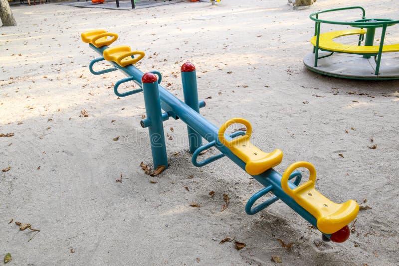 Children's rocking, swing balancer on the playground. royalty free stock image