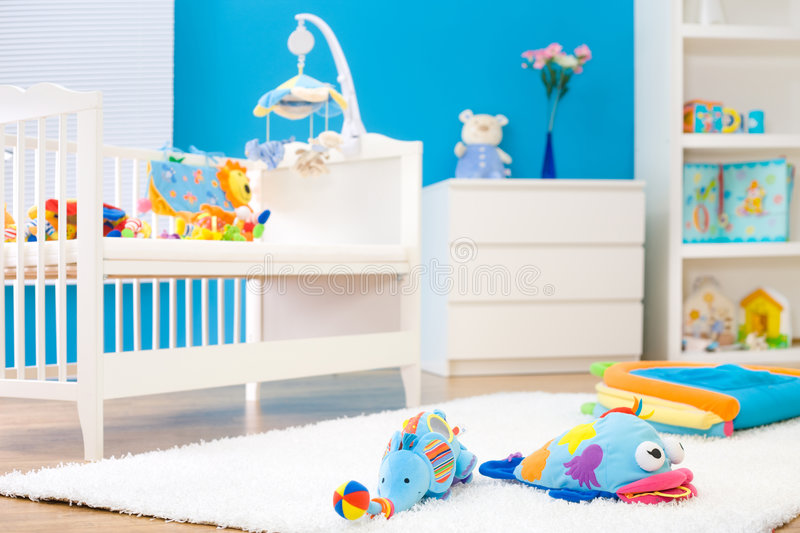 Children's Room. Crib and soft baby toys at children's room. Toys are officially property released royalty free stock images