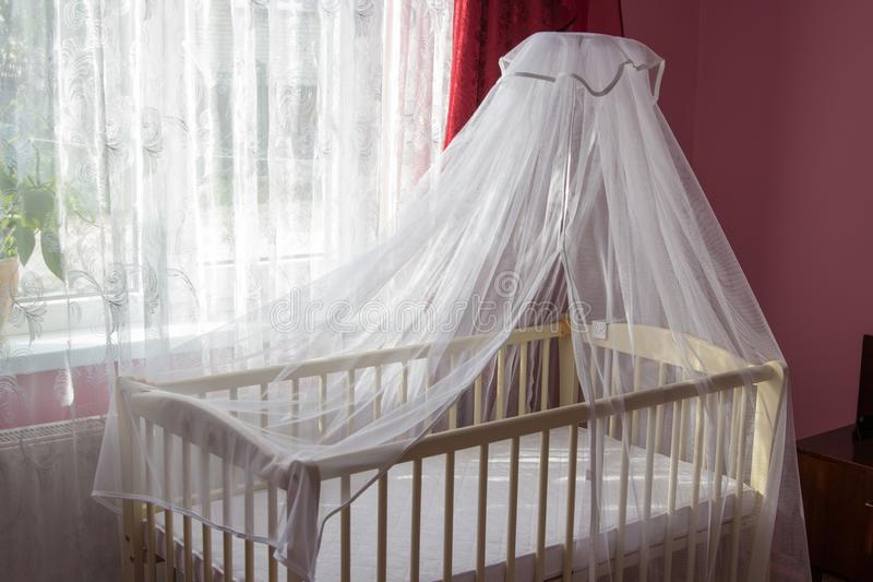 Baby crib for girls,Children`s room purple for a baby with a bed stock image