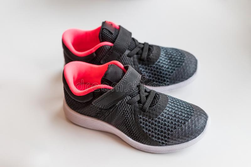 Children`s running shoes.New black pink sport shoes on white background.children shoes isolated.kids running. Children`s running shoes. on a white background royalty free stock images