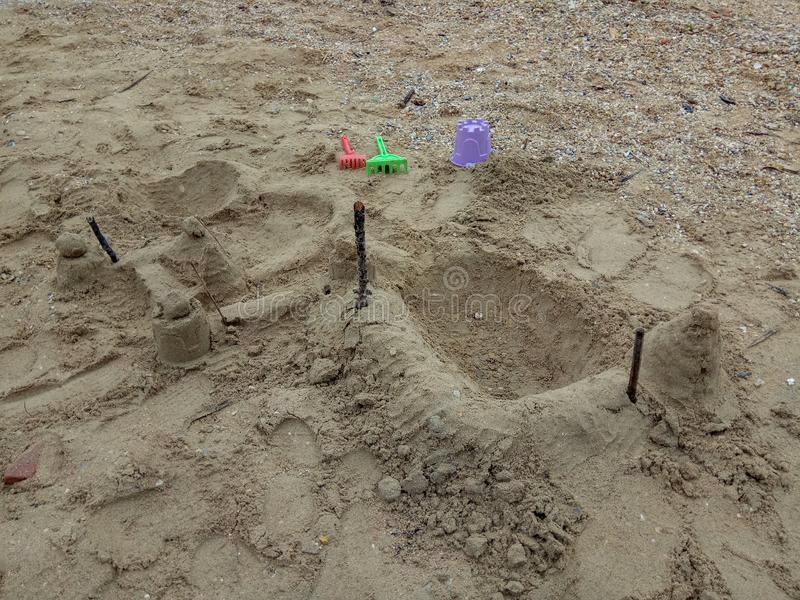 Children`s beach toys - buckets, spade and shovel on the sand stock image