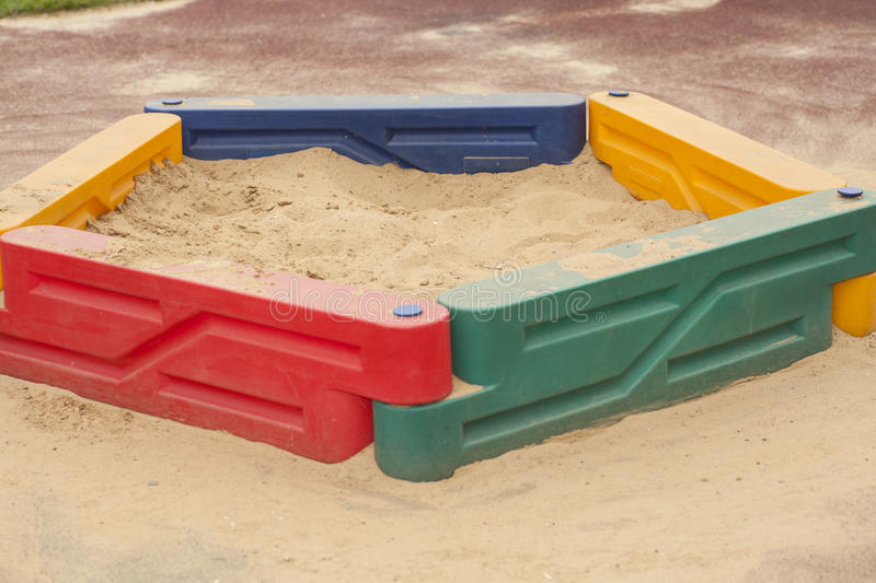 Children's sandbox with yellow sand stock photos