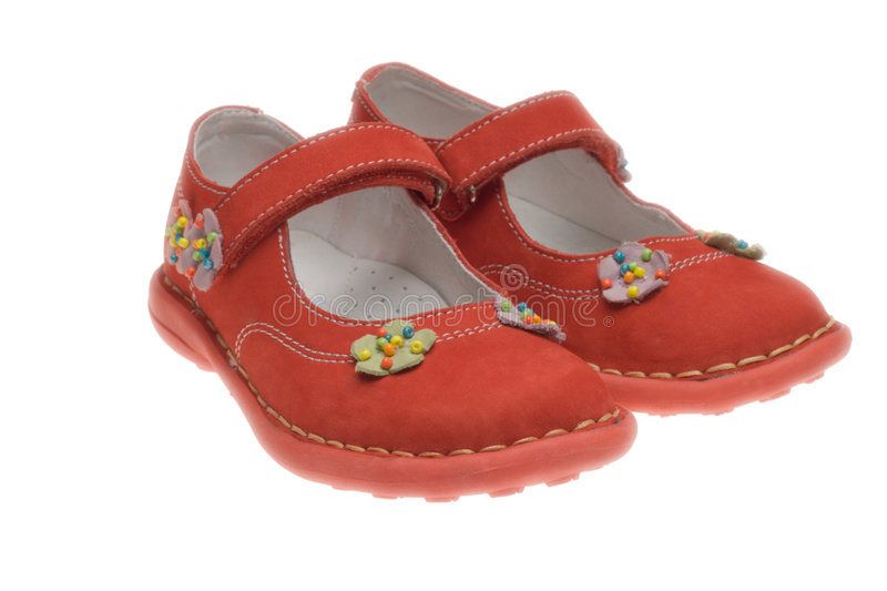 Children's shoes. A pair of red children's shoes over white stock image
