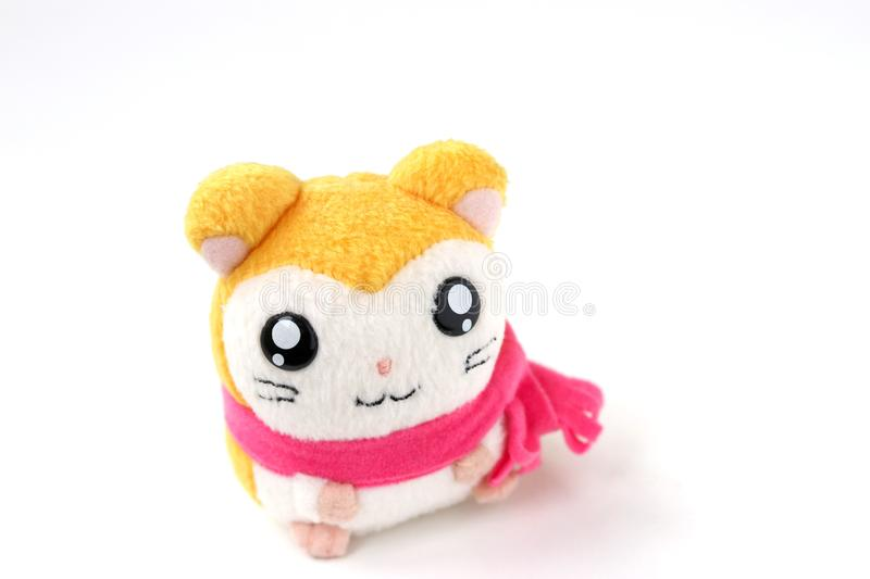 Children`s soft toy mouse in a pink scarf is located on a white background royalty free stock photos