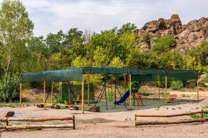 Children`s sports playground under a canopy in the open air in the summer. Children`s sports playground under a canopy from the sun`s rays in the open air in royalty free stock images