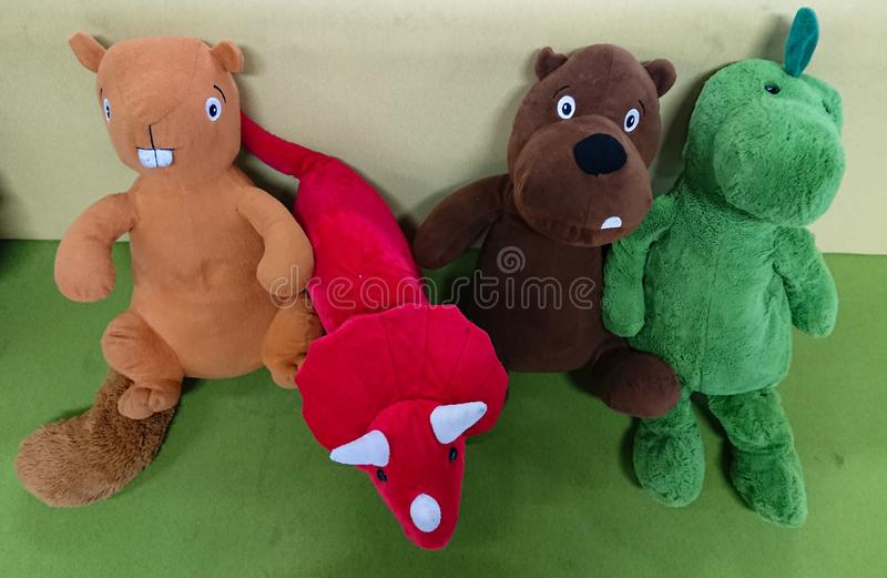 Children& x27;s stuffed toys. On a green grey background stock images