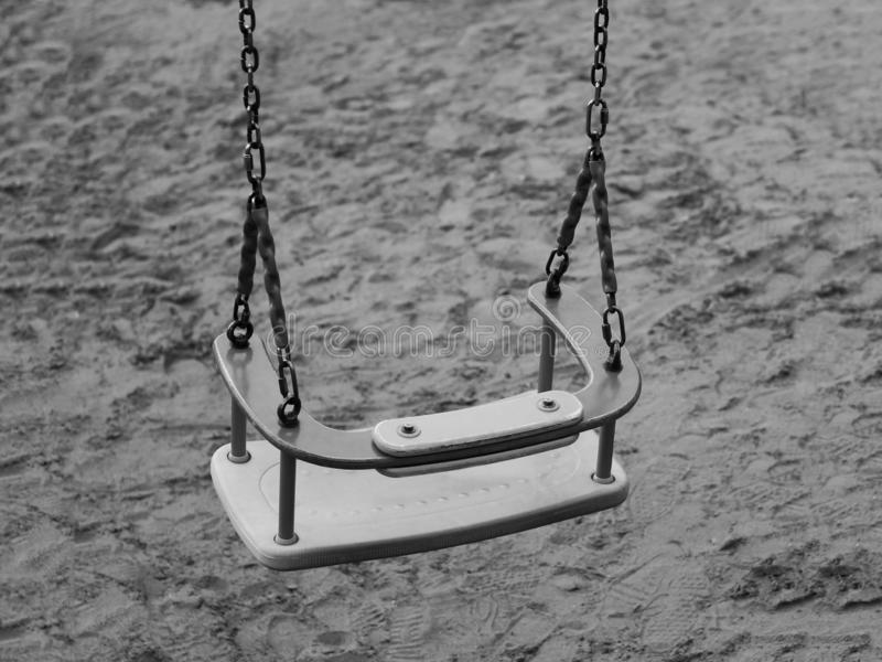 Children`s swing on the Playground, black and white stock images