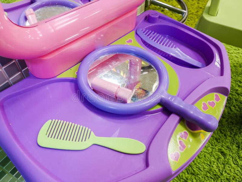 Children`s table for hair and lip coloring, children`s make-up. The dream of young beauties.  royalty free stock image